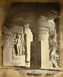 View from the interior of the Dumar Lena rock-cut temple, looking towards a supporting pillar of the verandah and sculpture of Durga, Ellora
